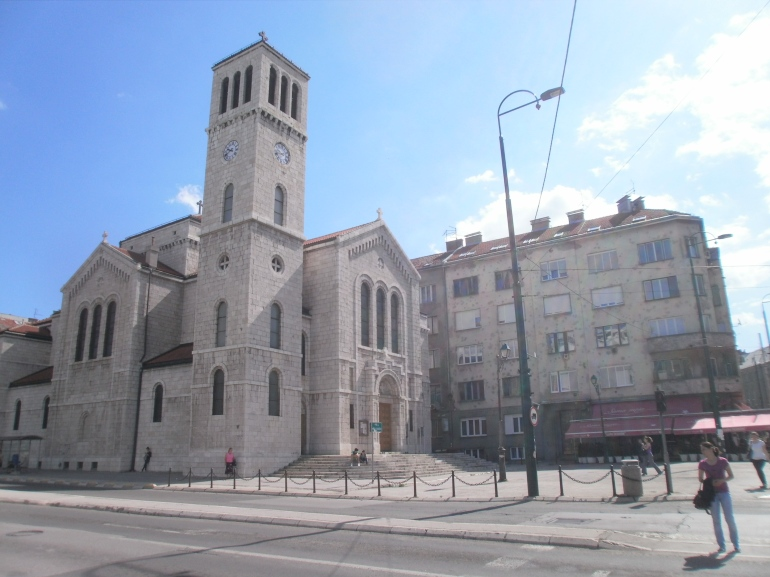 The mix in Sarajevo. A historic church beside a bullet ridden building