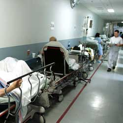 Scenes like this where patients are forced to wait on trolleys in hallways because they cannot afford a private room are outrgeous
